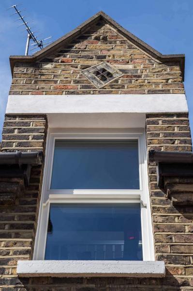 Replacement triple glazed sash window