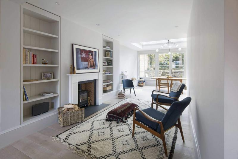 Beautiful fireplace in a low energy London property featuring MVHR - Enhabit Ltd