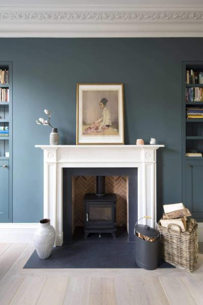 Centrepiece fireplace in a low energy home in London featuring MVHR - Enhabit