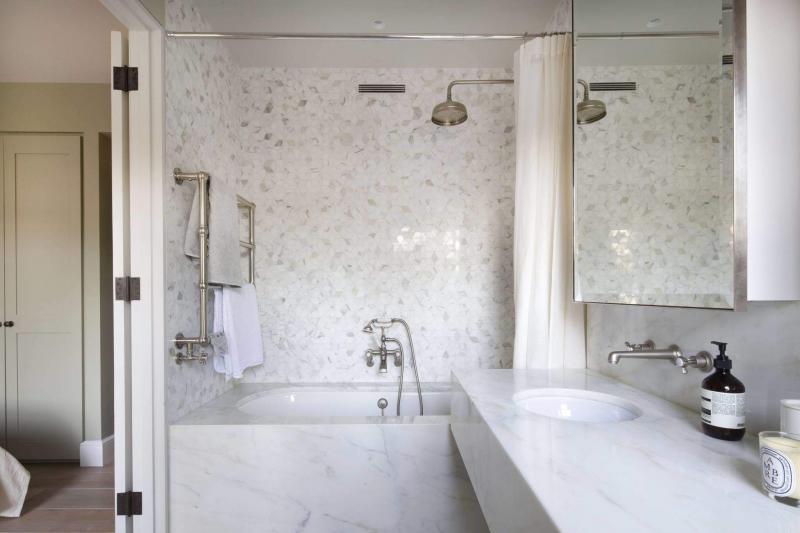 The MVHR ventilation grille is visible above the bathtub - Enhabit Ltd