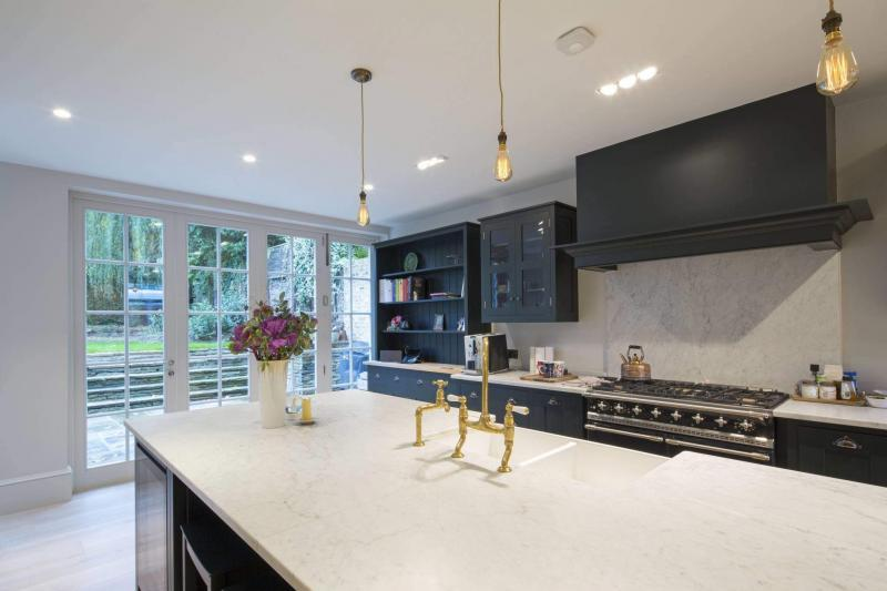 The kitchen of this low energy project in London has both an MVHR system and a cooker hood - Enhabit Ltd