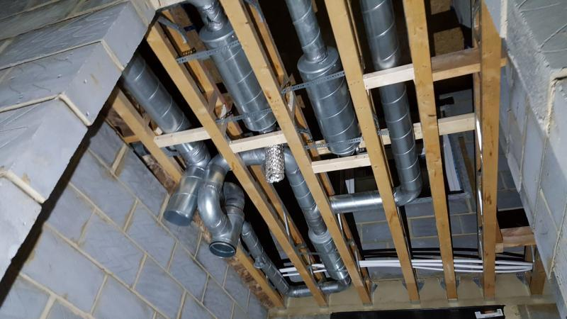 MVHR steel ducting fitted into joists - Enhabit