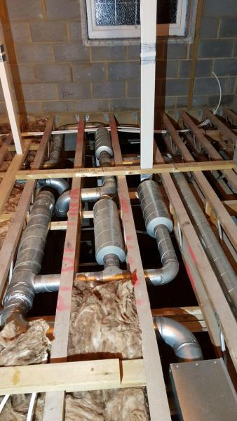 MVHR steel rigid ducting fitted into joists - Enhabit